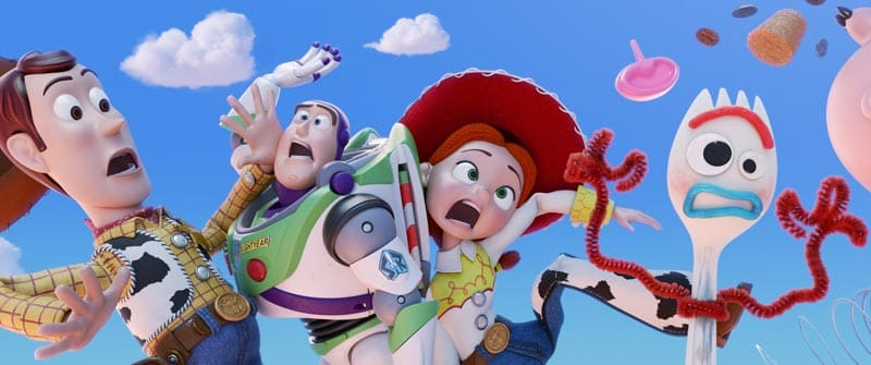 Toy Story 4 characters floating in front of clouds